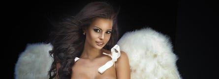 Beautiful brunette angel. Stock Photos