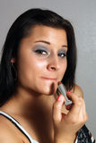 Beautiful Brunette Applying Lipstick (2) Royalty Free Stock Photo