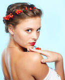 Beautiful brunette with ashberries Stock Image