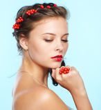 Beautiful brunette with ashberries Royalty Free Stock Photo