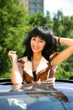 Beautiful brunette in the automobile Royalty Free Stock Images