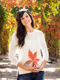 Beautiful brunette with autumn leaf Royalty Free Stock Images