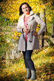 Beautiful brunette in the autumnal park Royalty Free Stock Photo
