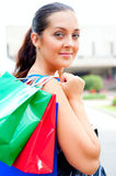 Beautiful brunette with bags Stock Image