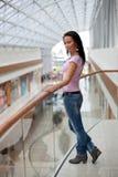 Beautiful brunette on a balcony Stock Photos
