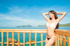 Beautiful brunette basking in the sun. Relax Royalty Free Stock Image