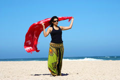 Beautiful brunette on the beach Royalty Free Stock Photography