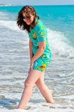 Beautiful brunette on the beach Royalty Free Stock Image