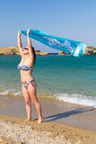 Beautiful brunette on the beach of Greece Stock Photography