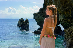 Beautiful brunette on beach half-turned to the sea Royalty Free Stock Images