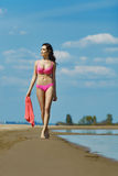 Beautiful brunette on the beach on a hot summer day Royalty Free Stock Image