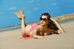 Beautiful brunette on the beach on a hot summer day Royalty Free Stock Photos
