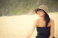 Beautiful brunette at the beach Royalty Free Stock Image