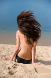 Beautiful brunette on  beach sunbathes Stock Photography