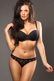 Beautiful brunette beauty in black underwear Royalty Free Stock Image