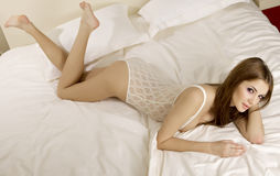 Beautiful brunette in bed Royalty Free Stock Image