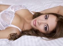 Beautiful brunette in bed Stock Photography