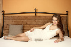 Beautiful brunette in a bedroom Stock Images