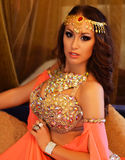 Beautiful brunette, belly dancer in the arabic harem interior. Beautiful belly dancer in the arabic harem interior Royalty Free Stock Images