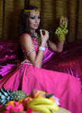 Beautiful brunette, belly dancer in the arabic harem interior. Beautiful belly dancer in the arabic harem interior Stock Images