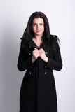 Beautiful brunette in a black coat. Royalty Free Stock Photo