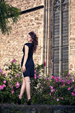 Beautiful brunette in black dress in old city Royalty Free Stock Photography