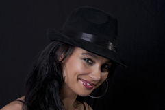 Beautiful brunette with black hat Royalty Free Stock Photos