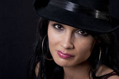 Beautiful brunette with black hat Stock Photography