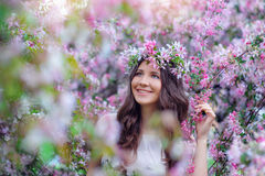 Beautiful brunette in the blossoming spring garden Royalty Free Stock Photo