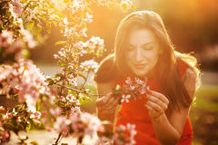 Beautiful brunette in the blossoming spring garden Stock Photo