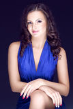 Beautiful brunette in blue dress Royalty Free Stock Photography