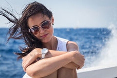 Beautiful brunette on a boat Stock Image