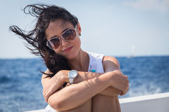 Beautiful brunette on a boat Stock Images