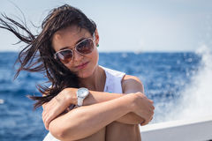 Beautiful brunette on a boat Royalty Free Stock Photography