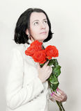 Beautiful brunette with bouquet of roses royalty free stock image