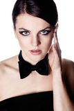 Beautiful brunette with bow tie Royalty Free Stock Photos
