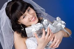 Beautiful brunette bride with presents Stock Photo