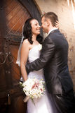 Beautiful brunette bride smiling at groom at yard of castle Royalty Free Stock Images