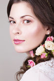 Beautiful brunette bride smiling with natural make up and flowers roses in her hairstyle Royalty Free Stock Image