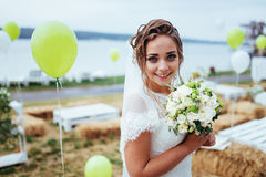 Beautiful brunette bride in a white dress at wedding Royalty Free Stock Images