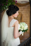 Beautiful brunette bride with white roses bouquet Royalty Free Stock Photos