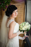 Beautiful brunette bride with white roses bouquet in vintage dre Royalty Free Stock Image