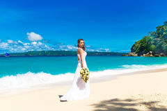 Beautiful brunette bride in white wedding dress with big long wh Royalty Free Stock Photography