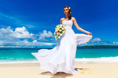 Beautiful brunette bride in white wedding dress with big long wh Stock Photo