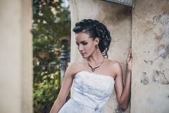 Beautiful brunette bride in white wedding dress Stock Photography