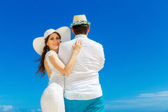 Beautiful brunette bride in white wedding dress and straw hat an Royalty Free Stock Photo