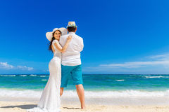 Beautiful brunette bride in white wedding dress and straw hat an Royalty Free Stock Photos