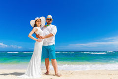 Beautiful brunette bride in white wedding dress and straw hat an Royalty Free Stock Images