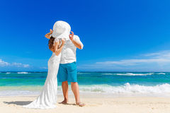 Beautiful brunette bride in white wedding dress and straw hat an Royalty Free Stock Image