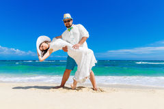Beautiful brunette bride in white wedding dress and straw hat an Royalty Free Stock Photography